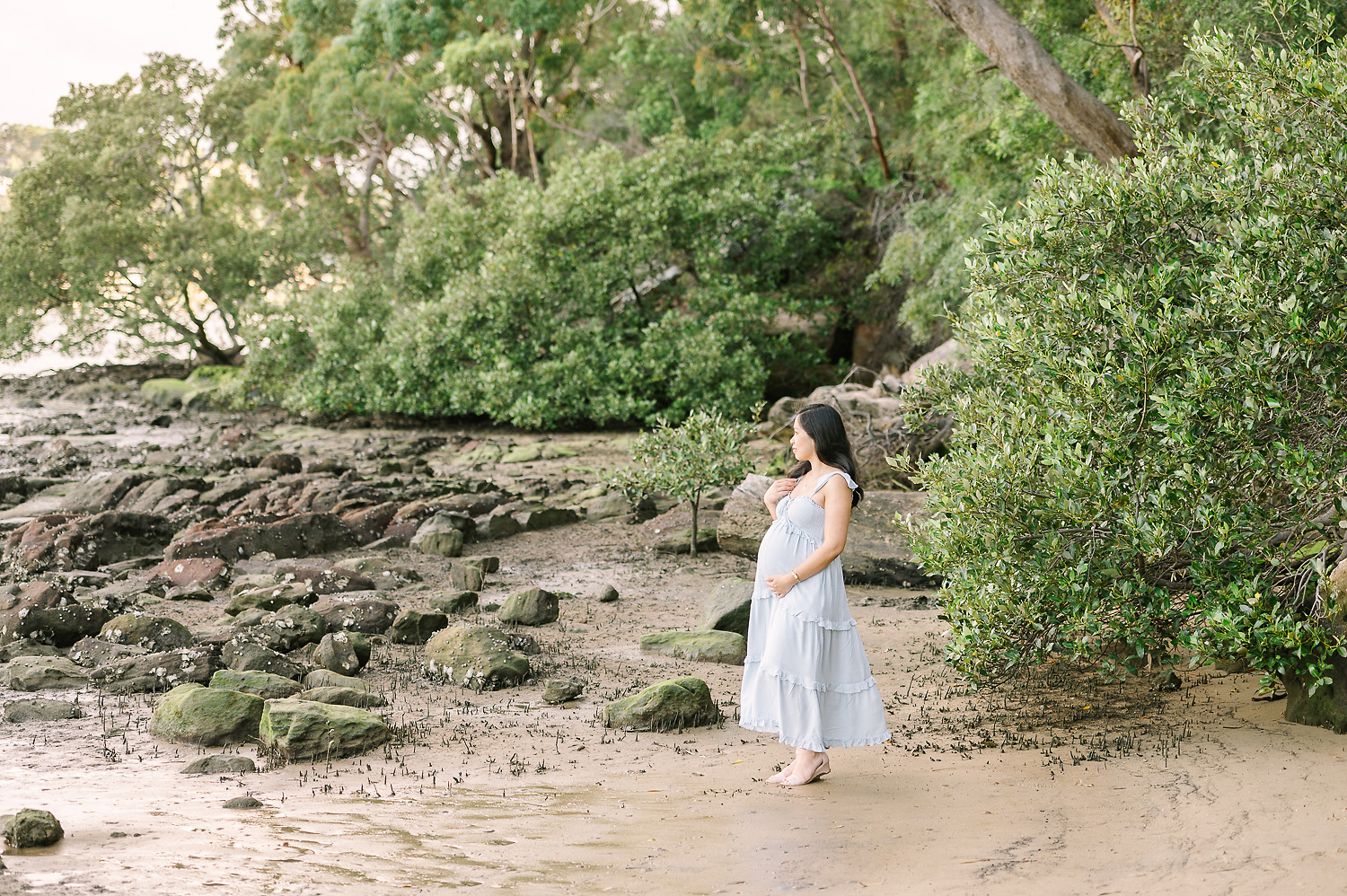 Pregnant woman looking at river as photographed by Sutherland Shire Maternity Photographer Sevenish Photography