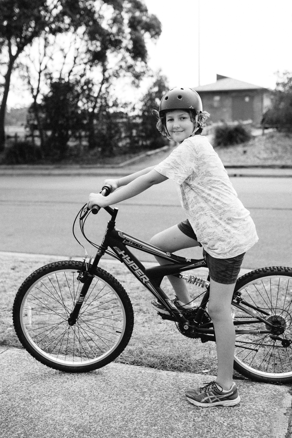Black and White Image of young boy on bike in Sutherland Shire Sydney